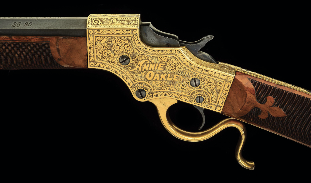 A closeup on the gold-plated frame of the Annie Oakley gun, clearly showing the name of its recipient. The Stevens company apparently gave her this early model 44 in 1893.