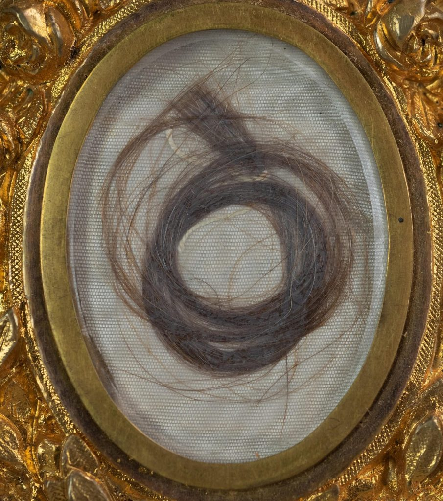 """A detail shot of the lock of Washington's hair. It's described as a """"substantial"""" lock because it consists of several long strands of reddish-brownish-greyish hair, and not just a few wisps."""