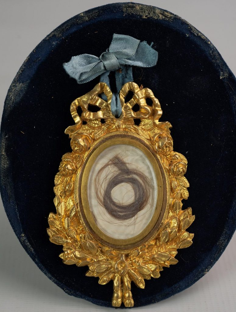 A lock of George Washington's hair, taken late in 1798 in Philadelphia. It was preserved in an elaborate locket decorated with gold leaf. The memento of America's first president could sell for $25,000 or more.