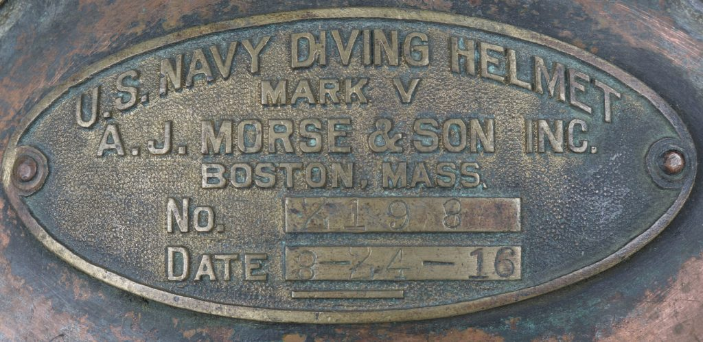 A detail shot of the identification plate on the U.S. Navy Mark V diving helmet, confirming it was made in 1916.