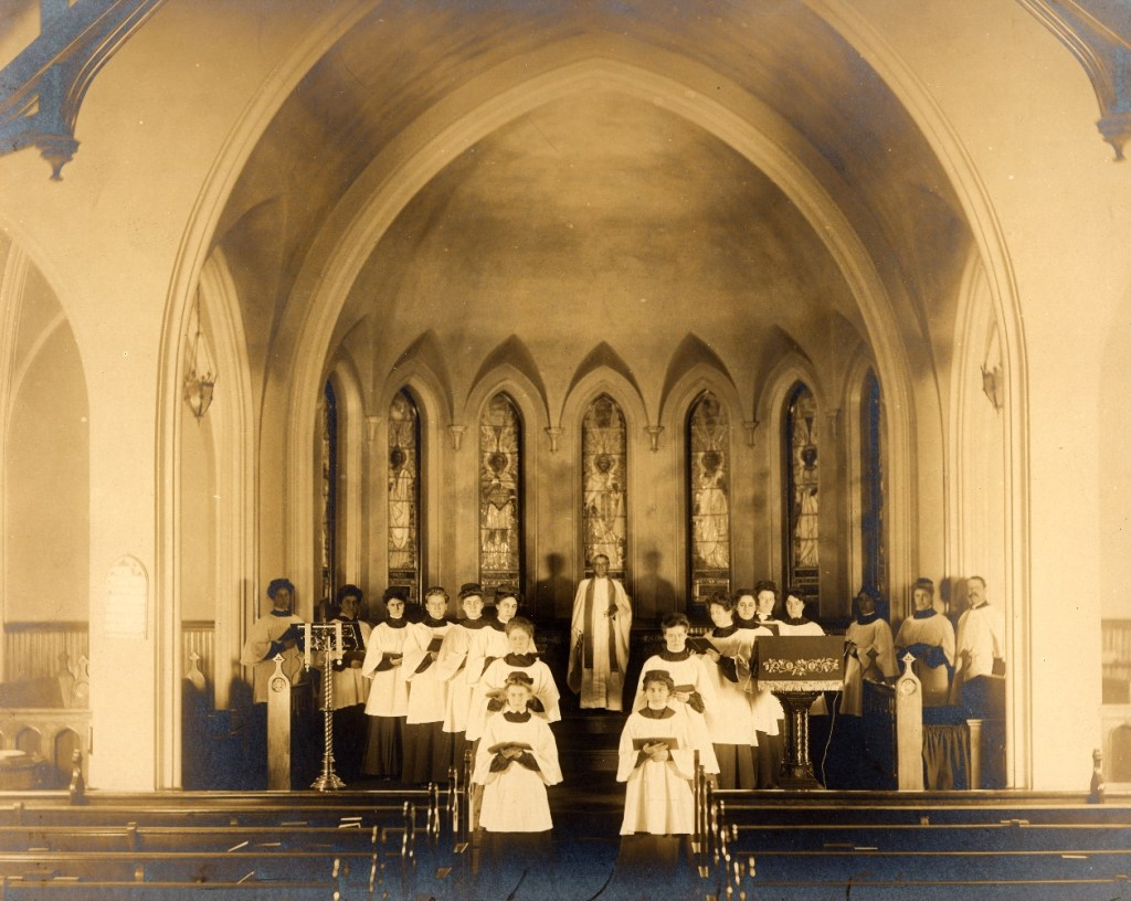 A period photo of an interior of the Church of the New Jerusalem, showing the seven Tiffany windows in place.
