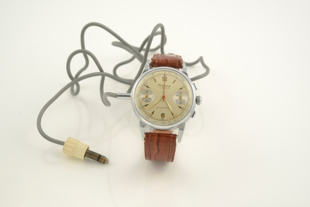 This particular example of the Protona Minifon Mi-51 watch survives with its false watch and its wire. The recording device and the carrying case are lost.
