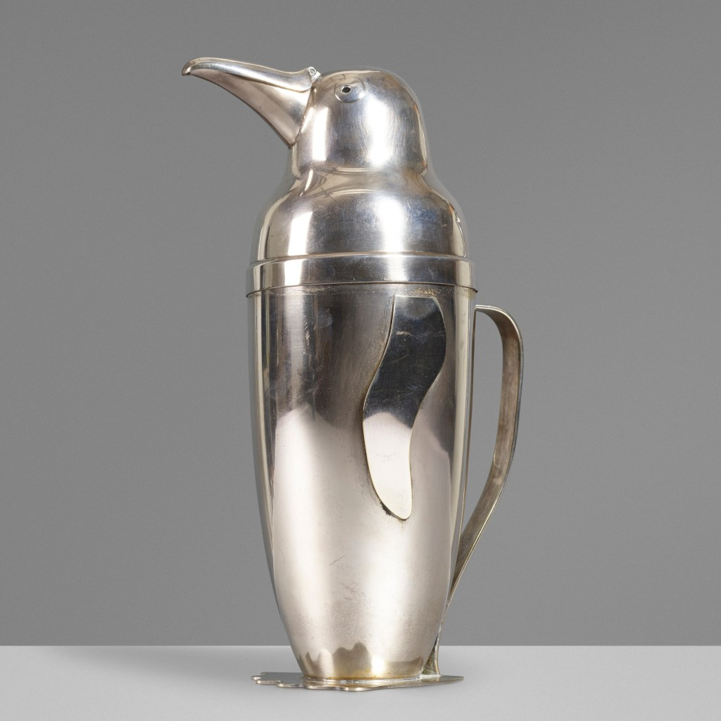 The Emil Schuelke vintage penguin cocktail shaker, shown from the side. The inventive design turns its beak into a spout.