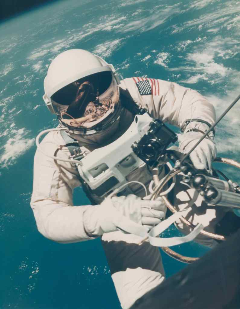 Astronaut Ed White floats over Hawaii during the first American spacewalk in June 1965. The large-format photograph could sell for more than $10,000.