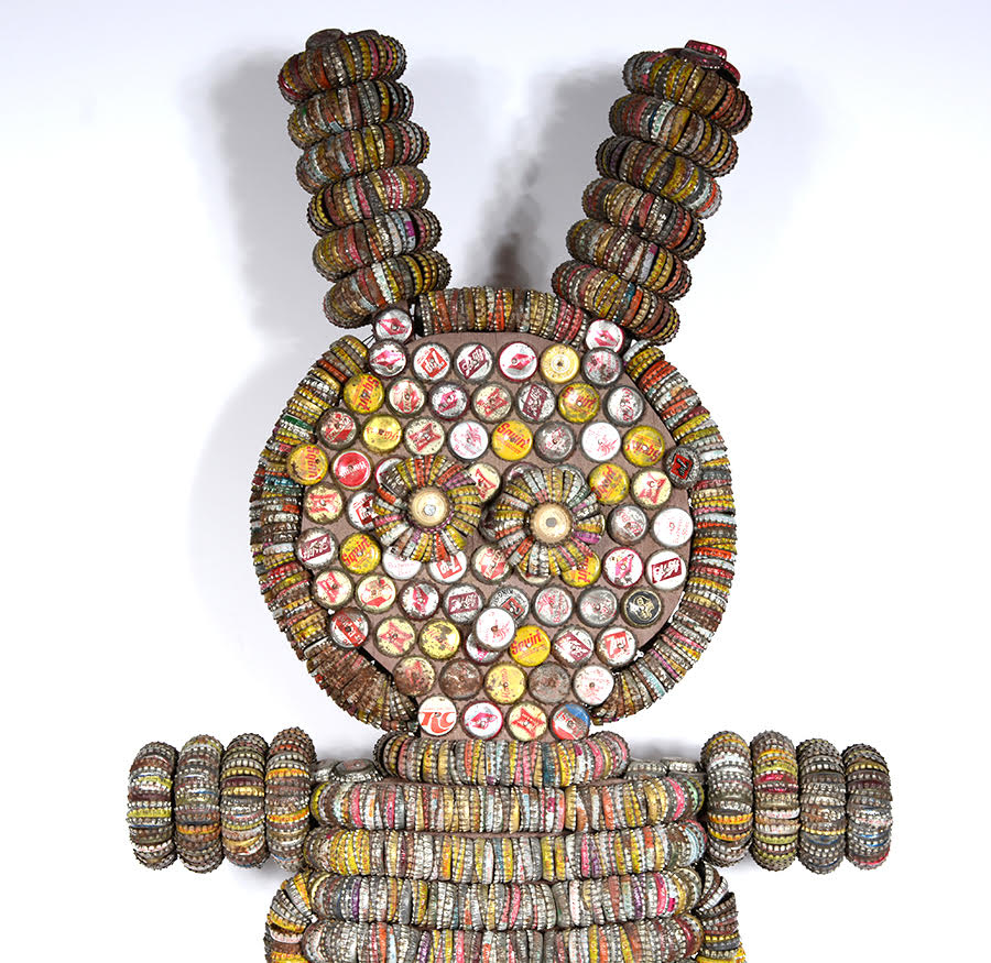 The upper half of the body of the Woolsey bunny figure clearly shows rings of bottle caps, which Grace pierced and strung on wires before incorporating them into the piece.