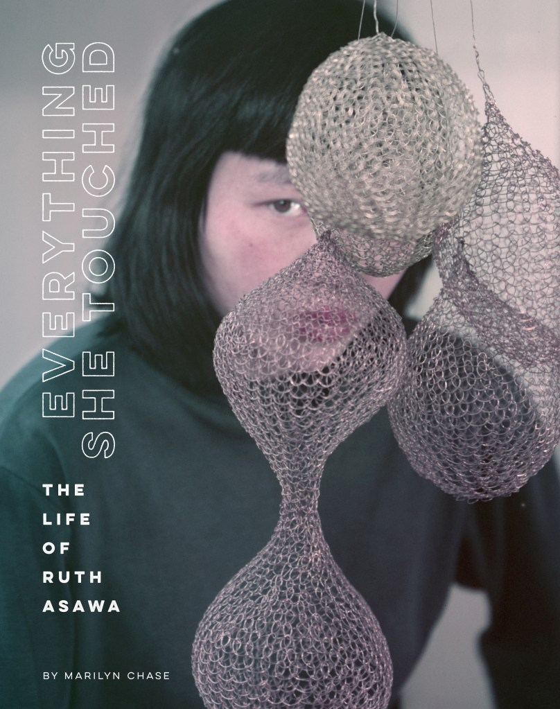 The cover of Everything She Touched: The Life of Ruth Asawa features a 1951 color photograph of the artist, taken by Imogen Cunningham. It captures her story: Asawa has always been here, hiding in plain sight. Her brilliance persists whether we choose to see it or not.