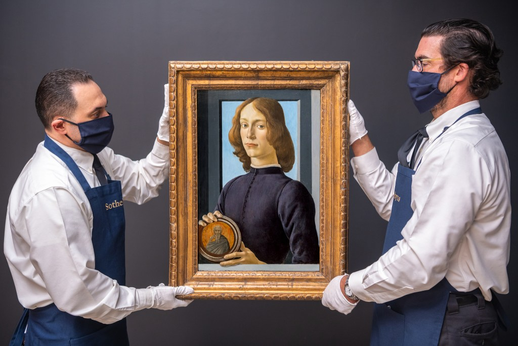 A telling detail: The Sotheby's porters have donned white gloves as well as face masks to handle this 15th century Botticelli masterpiece.