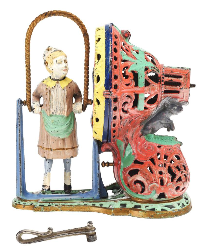 The girl skipping rope mechanical bank, shown with its key.