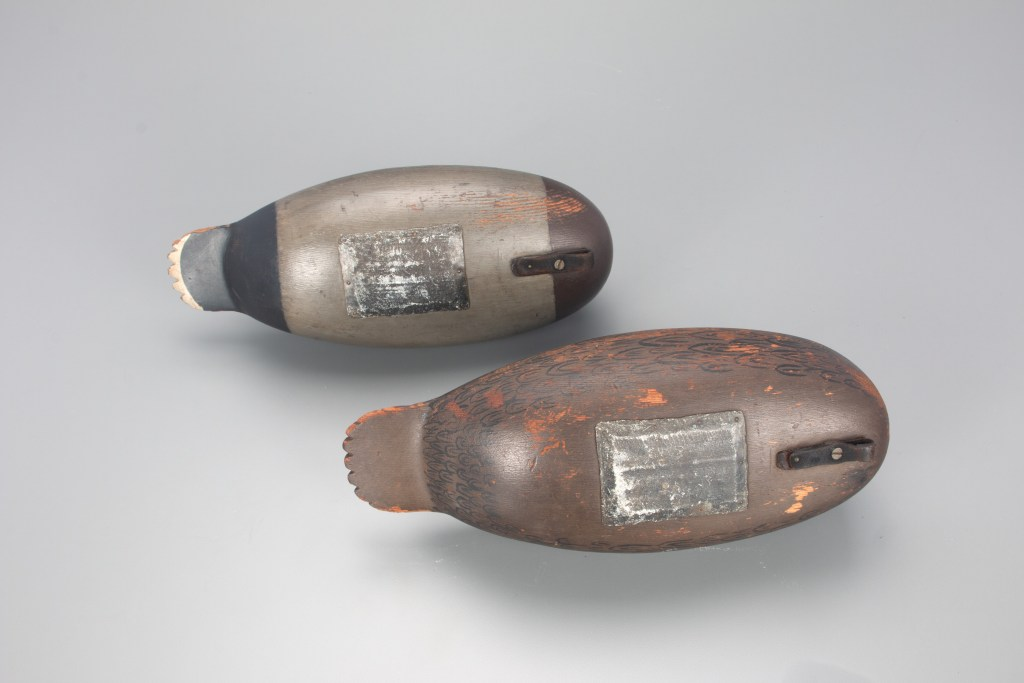 The hollow-bodied Jess Heisler duck decoy pair have chamfered lead pad weights on their undersides, which allow them to almost hover above a surface.