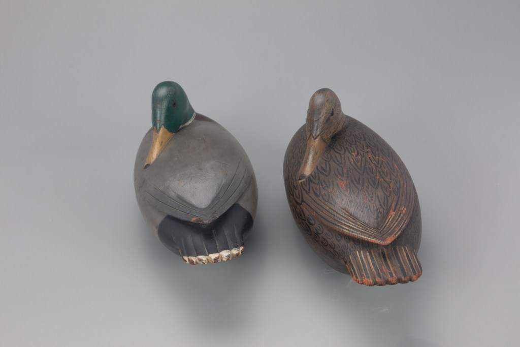 When the duck decoy pair is shown from the rear, the charm of the feather pattern Jess Heisler painted on the hen stands out.
