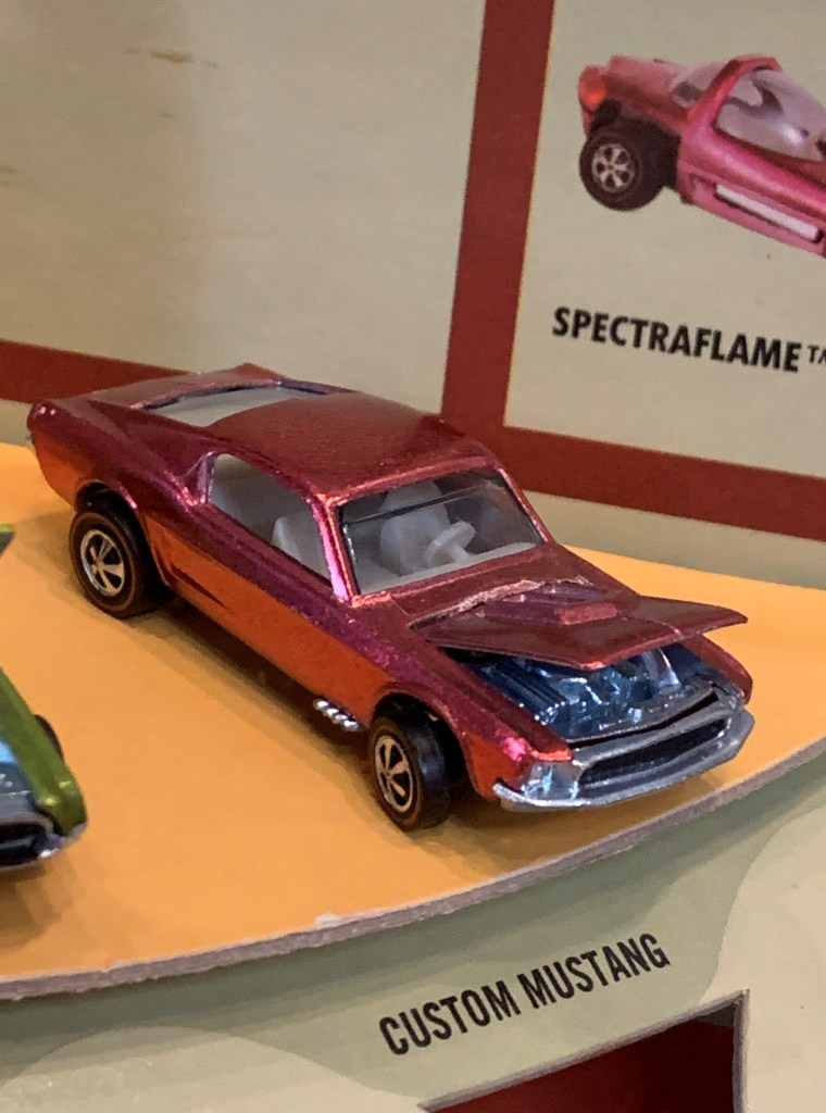 One car in the 1968 Hot Wheels store display is unusually rare--the watermelon pink Mustang. Other versions of the display contained an equally rare chocolate brown Camaro.