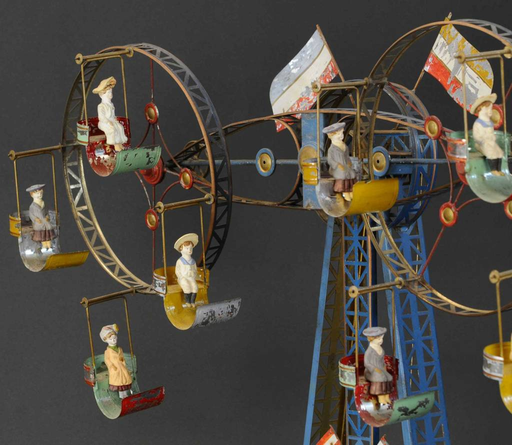 A detail shot of the rider figures on the double Ferris Wheel. All are detachable from their gondolas, and all have survived intact.