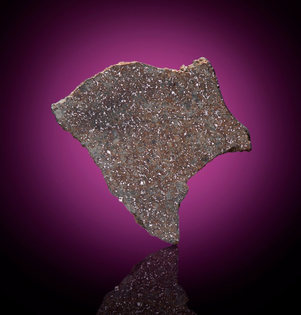 This tiny Barbotan meteorite, estimated at $2,000 to $3,000, could sell for triple its weight in gold at Christie's.