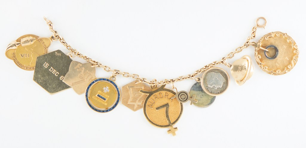 Jo Schirra's charm bracelet, a string of nine space-flown charms that tell the story of the early years of America's space program, could command $55,000.