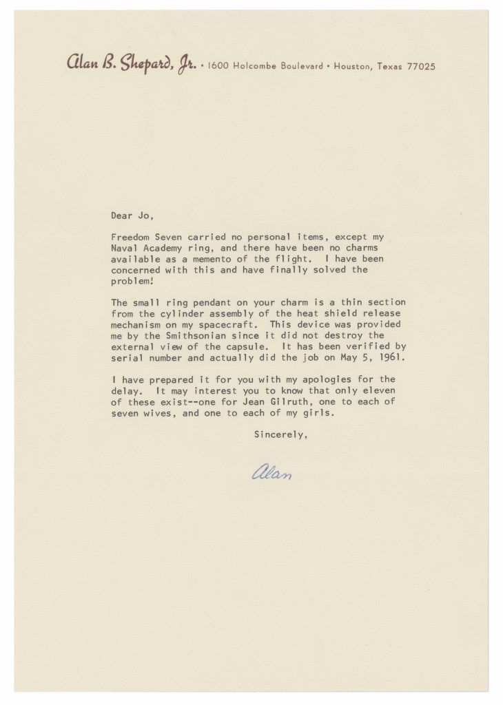 Alan Shepard wrote a letter of authentication for the fragment of Freedom 7 that graces Jo Schirra's charm bracelet.