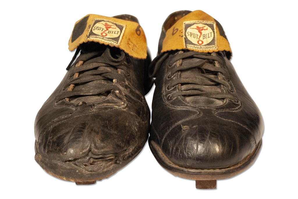 The Ted Williams cleats, shown from the front. Clearly game-worn, the cleats show a good amount of wear, not too much.