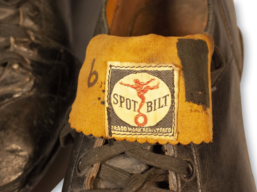 The Ted Williams cleats were manufactured by Spot Bilt.