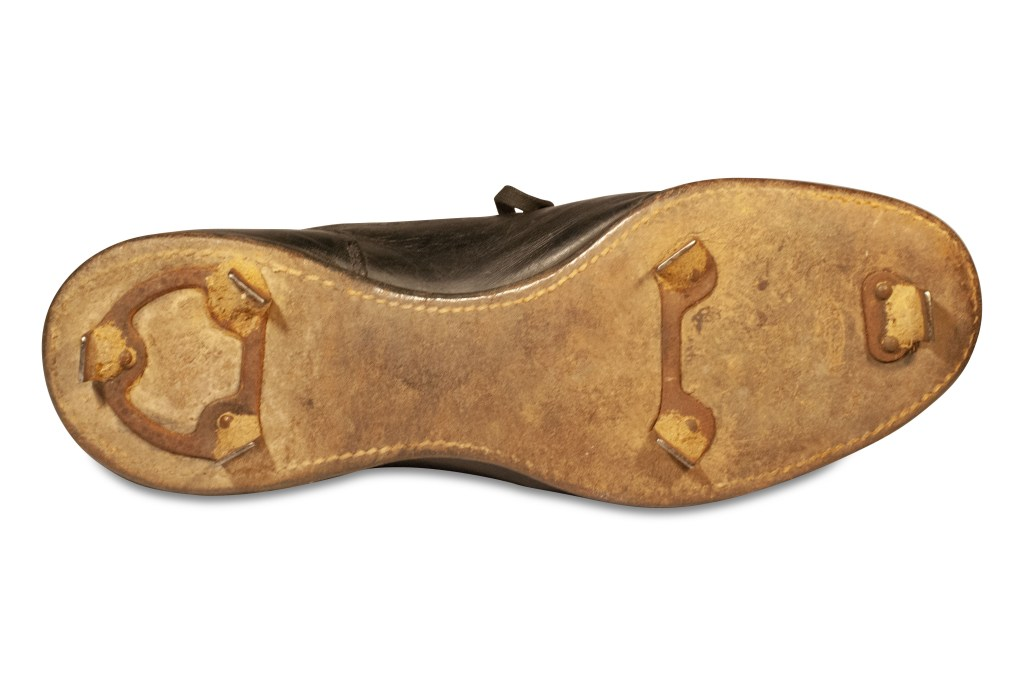 The Ted Williams cleats, tilted to show the spikes installed on their soles.