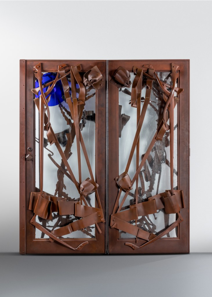 The Albert Paley doors shown from the rear, or as the occupants of the home would have seen them as they approached the doors to let guests in.