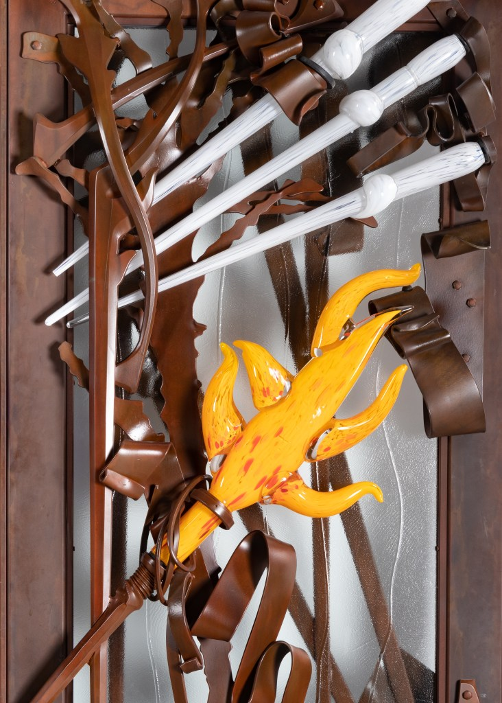 Detail of Albert Paley doors, showing colorful glass elements by Martin Blank.